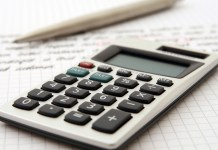 calculator and pad of paper for working out business tax
