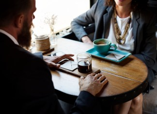 businessman and woman meeting and drinking coffee