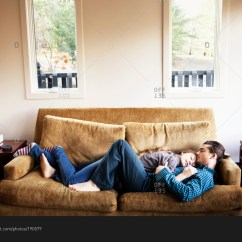 Sleeping In A Chair Gif Hanging Canopy Couple Cuddling And On Couch Together Stock Photo