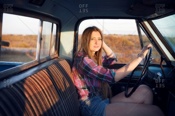 Young woman driving a pick up truck stock photo OFFSET