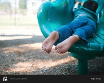 View Of Child' Dirty Bare Feet Slides