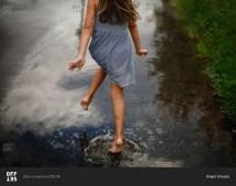 Girl Running Barefoot Puddle Street Stock