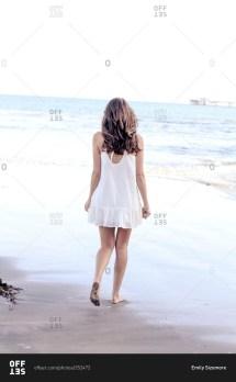 Woman Walking Barefoot in Dress
