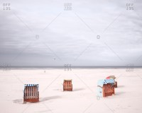 covered beach chair stock photos