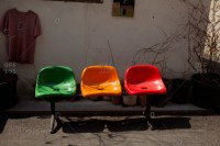 Three plastic chairs in a yard stock photo - OFFSET