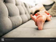 Close Of Little Boy' Bare Feet Couch Stock