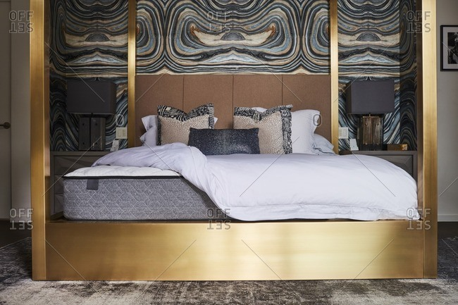gold four poster bed in modern bedroom