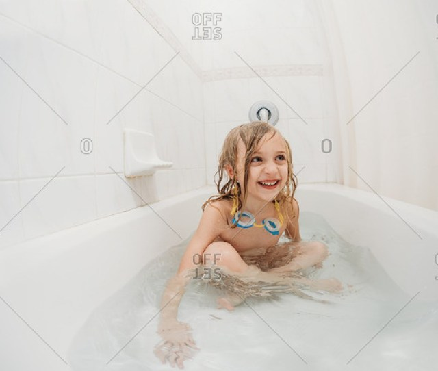 Little Girl Taking A Bath With Goggles Around Her Neck Stock Photo Offset