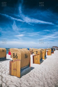 covered beach chair stock photos - OFFSET
