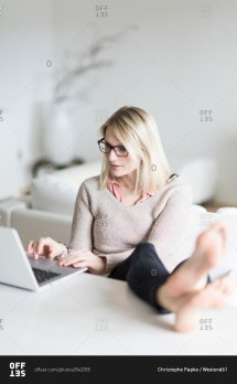 Blond Woman Sitting Table With Feet Laptop