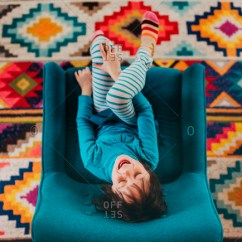 Chair Rail Upside Down West Elm Wing Stock Photos Offset Top View Of Excited Brunette Girl Sitting In