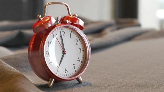 Old Vintage Red Alarm Clock Stock