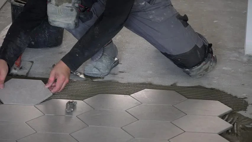 professional worker laying hexagon stone stock footage video 100 royalty free 1026632000 shutterstock