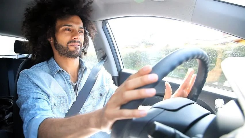 Cool Man Listening Music While Driving Car Traveling Stock
