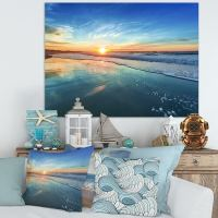 Shop Blue Seashore with Distant Sunset - Seashore Canvas ...