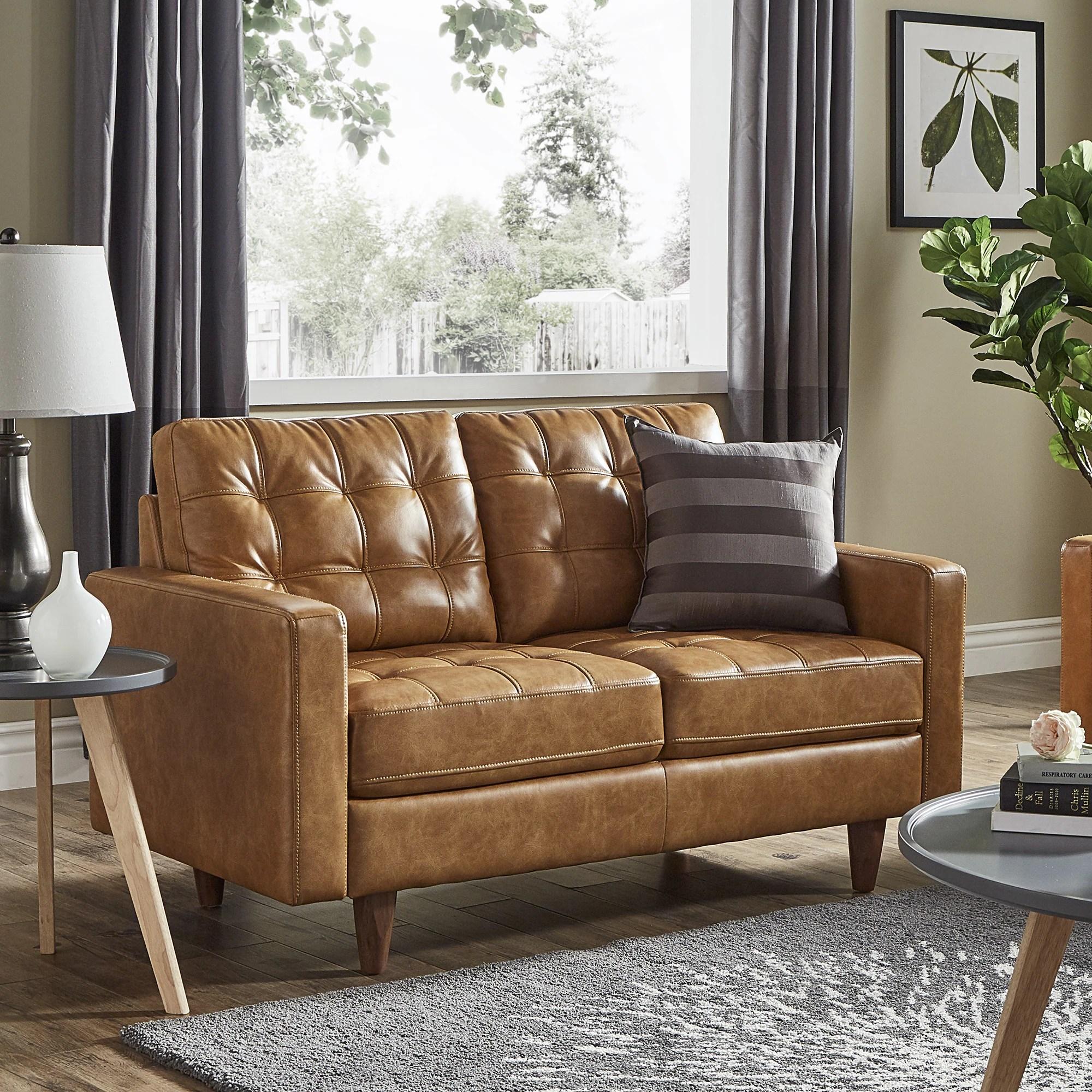 caramel colored leather sofas burlington sofa laura ashley carmel couch