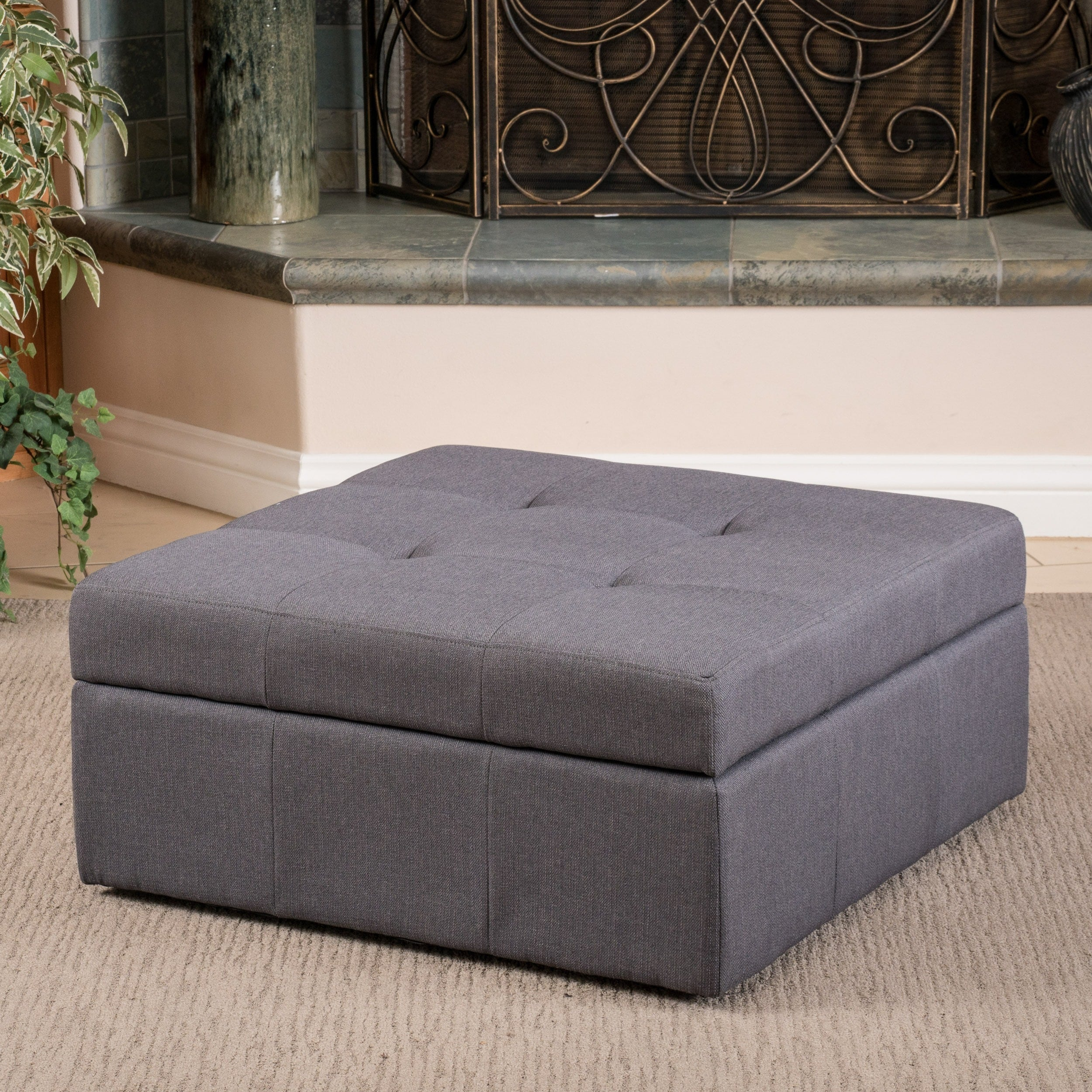 chatsworth contemporary tufted fabric storage ottoman with rolling casters by christopher knight home