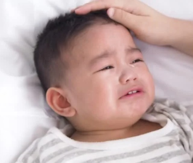 Asian Mother Trying To Calm Her Crying Baby
