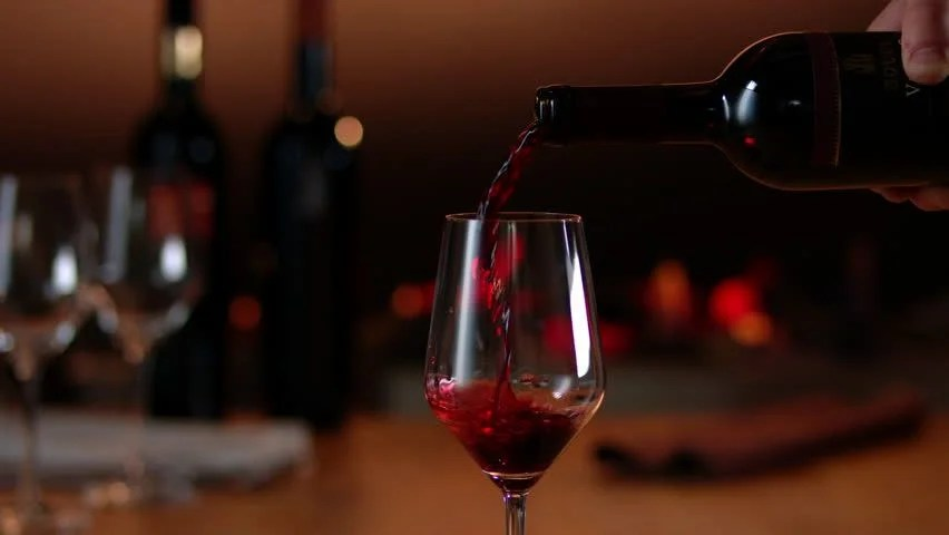 Close Up Of Wine Poured In Glass Isolated On A Dinner