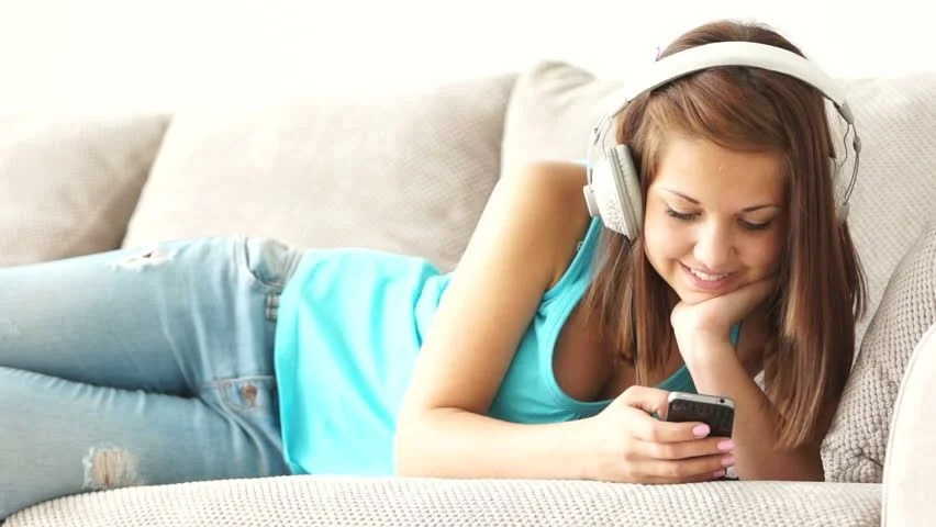Wallpaper For Teenage Girl Phone Happy Young Woman Lying On Sofa Using Laptop Looking At