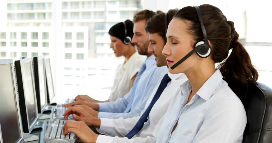 Smiling Call Centre Agents Working With Headset Stock