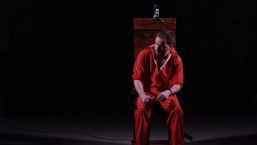 death by electric chair video gaming capital punishment stock footage 100 male prisoner sitting in awaiting sentence