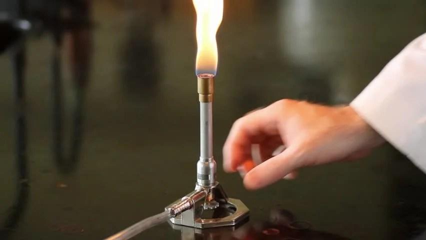 Stock video of adjusting the bunsen burner  1007392
