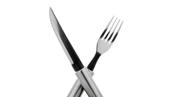 Knife And Fork Crossed And Rotating In A Seamless Loop On