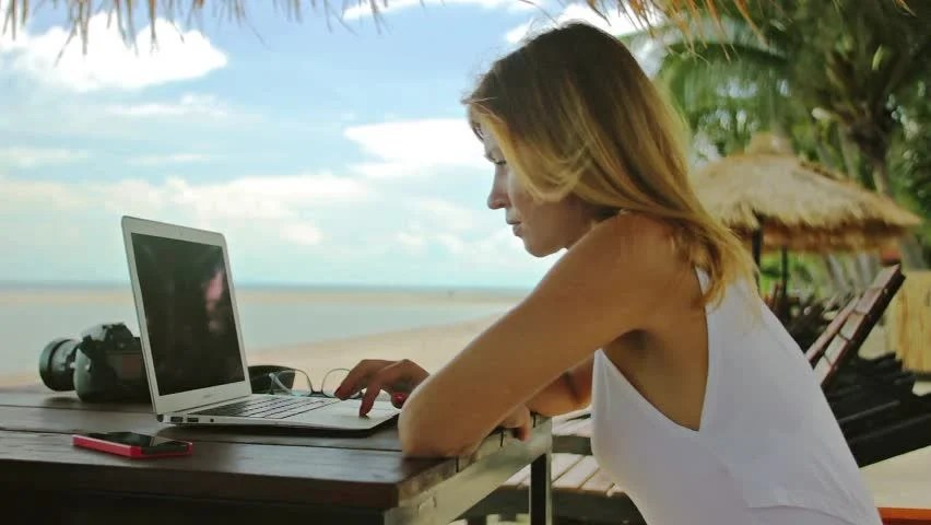 Hispanic Female In White Dress Working On Laptop In A