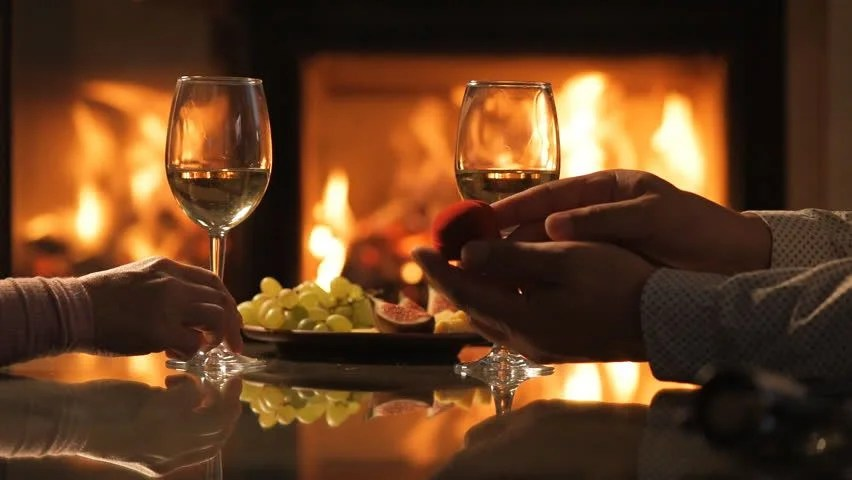 Couple Relaxing In Front Of Fireplace Man Looking At Woman Stock Happy Young Couple Sitting Near Fireplace And Drinking