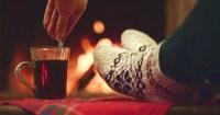 Woman By The Fireplace. Woman In Woollen Socks Taking A ...