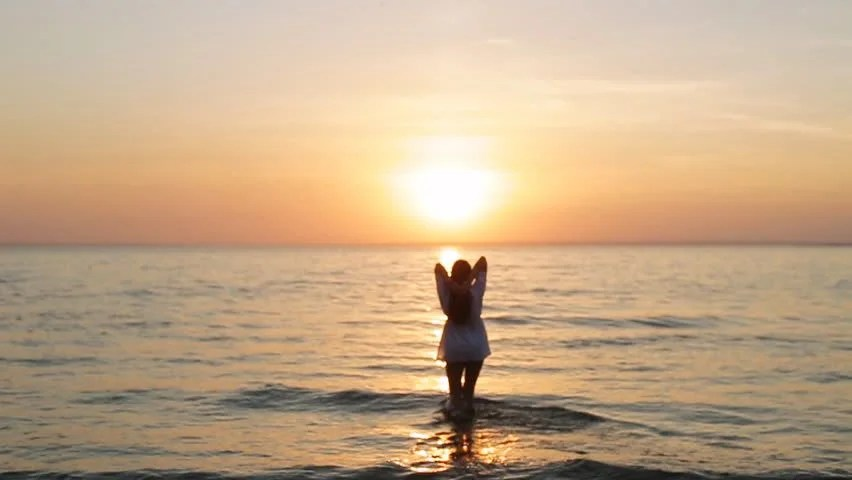 Girl Walking Alone Hd Wallpapers A Girl Walks Into The Sea At Sunset Slo Mo Stock Footage