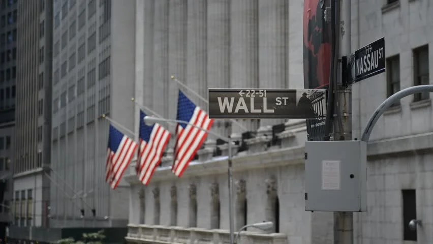Wall Street Sign With American Flags Purposely Blurred In Background HD Video Stock Footage