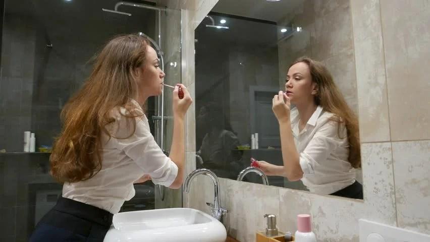 womandoinghairandmakeupinbathroom image  Free stock