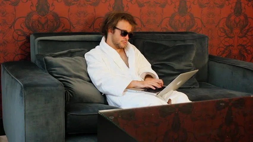 Image result for Man in bathrobe on computer