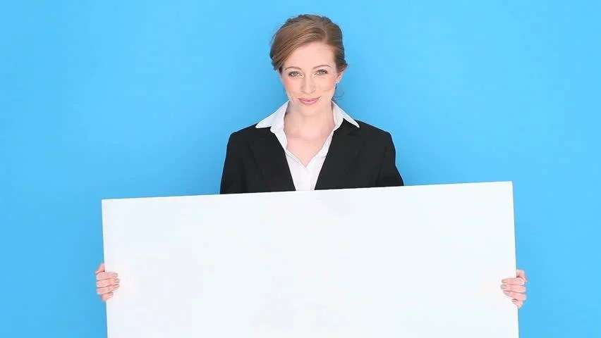 Stock video of happy smiling businesswoman holding a blank