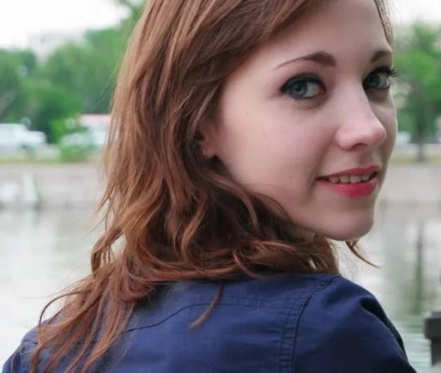 Cute Teenage Girl Turn And Look Back Smiling Handheld Footage