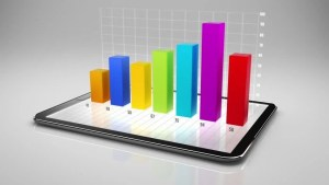 Digital Tablet With 3D Charts Black Background Loopable Tablet Turning With Growing Charts
