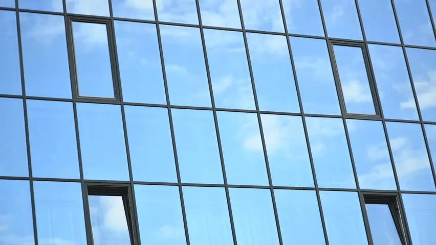 time lapse of clouds reflected in the windows of building hd stock foo e clip