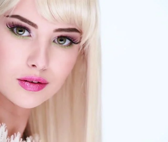 Beautiful Face Of A Sexy Girl With Long Straight Hairs And Pink Eye Make Up