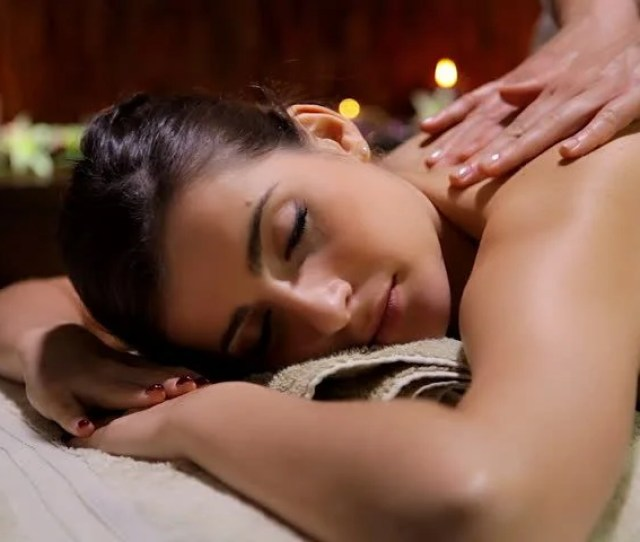 Beginning Of Massage With Oil In Spa Woman Relaxing