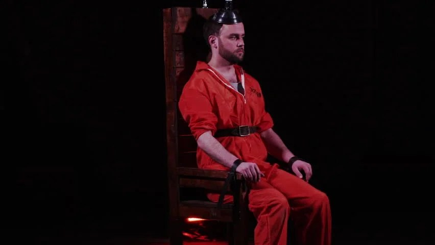 death by electric chair video leather swivel recliner chairs capital punishment stock footage 100 male prisoner sitting in awaiting sentence