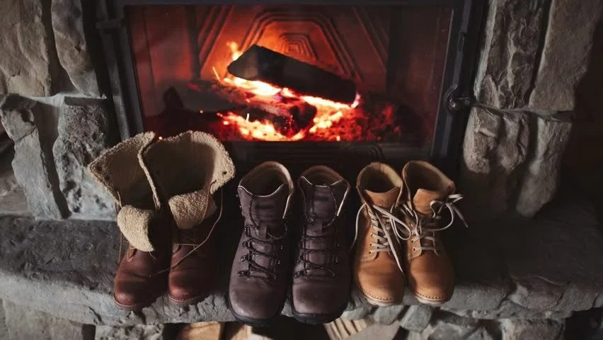 Couple Relaxing In Front Of Fireplace Man Looking At Woman Stock Couple Feet In Woollen Socks By The Cozy Fireplace, 4k
