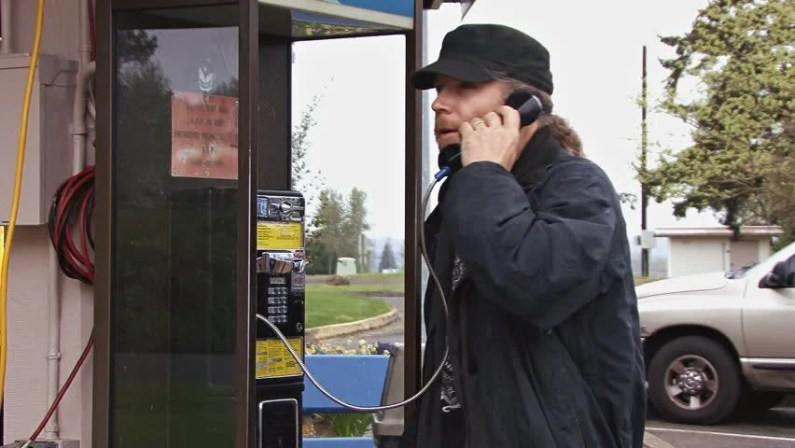 Image result for guy standing at a payphone