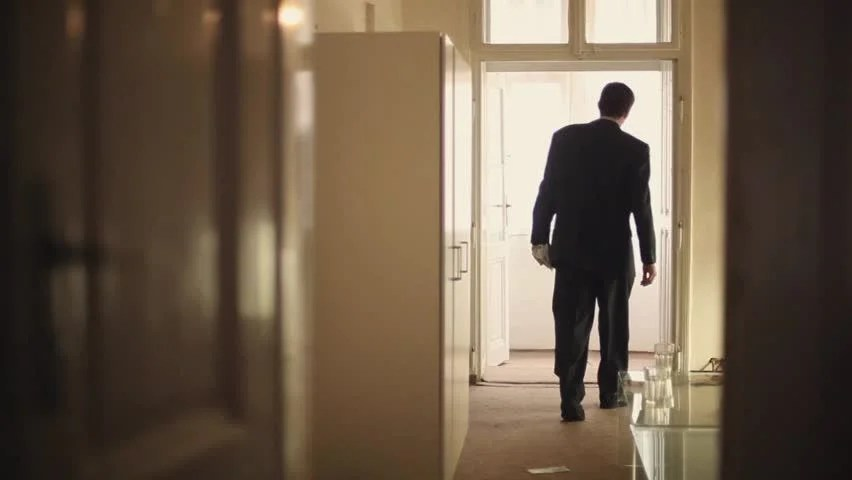 Stock video of man walk out of room  23237389  Shutterstock
