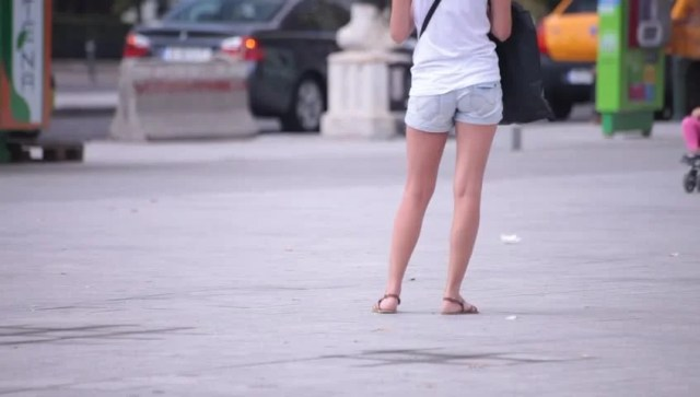 Hot Sexy Legs Of Young Adult Women Walking Down The Street Hot Weather Illustrative Shot