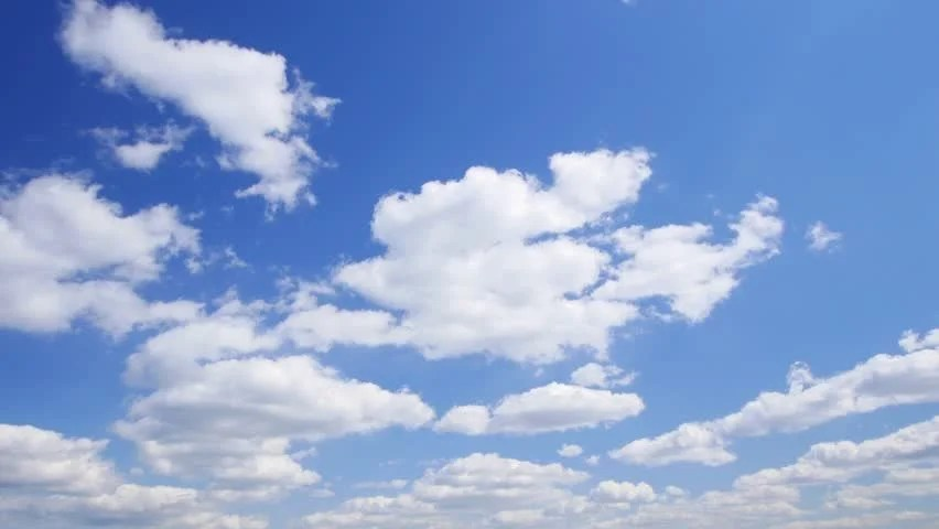Summer Clouds Fly Across A Royal Blue Sky HD 1080p