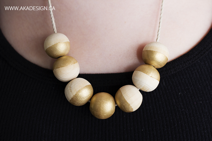 gold painted wood bead necklace