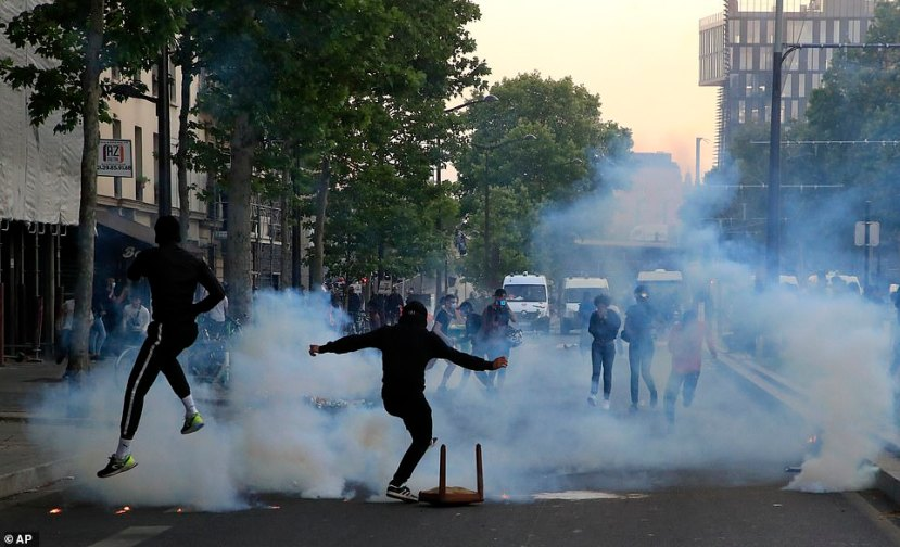 With the demonstration winding down, police fired tear gas and protesters could be seen throwing debris. Two small fires broke out, and green and grey barriers surrounding a construction site were knocked over