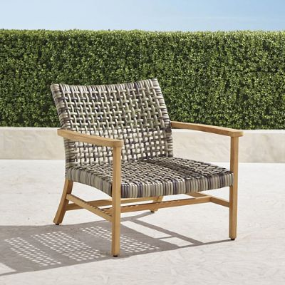 frontgate outdoor lounge chairs patio glider isola chair in natural finish